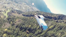 ICYMI: Some Humans Fly Now; And Give High Fives Whilst Doing So In The Alps