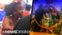 MOMMY SMACKDOWN: Woman Holding Baby Throws Punches at Chuck E Cheese (CAUGHT ON TAPE)