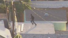 RAW VIDEO: Dramatic South LA Car Chase Ends With Rooftop Flee