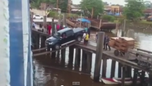 Meanwhile In The Third World, A Truck Drives The Plank Onto A Boat