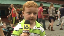 What Happens When You Give A Cute Kid The Microphone During A Live Interview? Give Up? Adorableness.