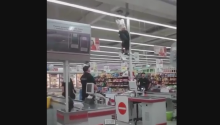 Shoplifter Tries To Escape Cops By Climbing Register - It Doesn't Work