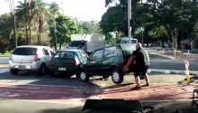 Man Lifts Car Parked In Bike Path