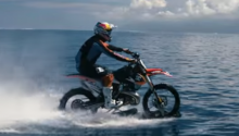 Daredevil Catches Wave on Motorbike