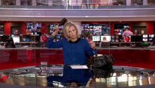 BBC Reporter Caught Brushing Hair