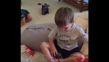 Toddler Receives Terrible Birthday Present But Plays It Off Like A Grown Up