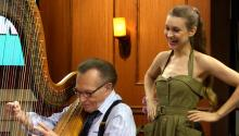 Watch Joanna Newsom Teach Larry King to Play the Harp!