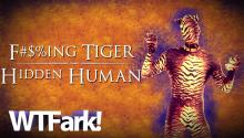 "F***ING TIGER, HIDDEN HUMAN: Man Is Arrested For Owning Video Of Woman Having Sex With A Tiger* (*Man In A Tiger Suit Yelling ""That's Grrrrrreat!"")"