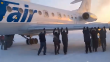 In Russia, Passenger Push Airplane!